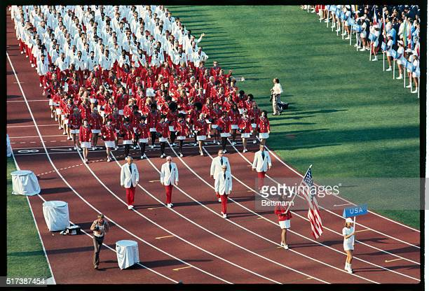 Munich, Germany. The Olympic team of the United States of America marches onto the track in Olympic Stadium preceded by the American Flag, carried by...