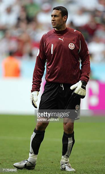 Tunisian goalkeeper Ali Boumnijel is seen during action against Saudi Arabia in their first round Group H World Cup football match at Munich's World...