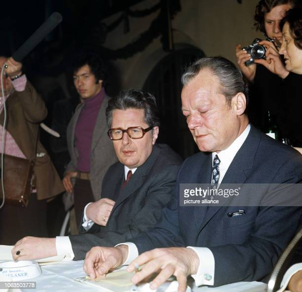 Munich lord mayor Dr HansJochen Vogel and Federal Chancellor Willy Brandt in a conversation during a conference of the SPD branch Munich on 8 March...