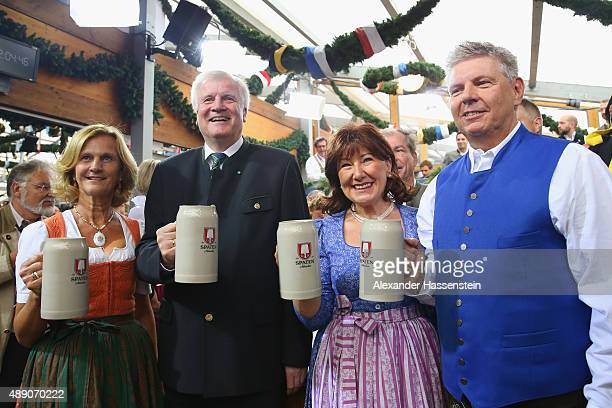 Munich Mayor Dieter Reiter and his wife Petra Reiter clink the first beer mugs with Bavarian Governor Horst Seehofer and his wife Karin Seehofer...