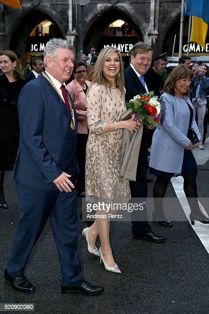 Munich mayor Dieter Reiter Queen Maxima King WillemAlexander of the Netherlands and Petra Reiter wife of Dieter Reiter walk across the Marienplatz on...