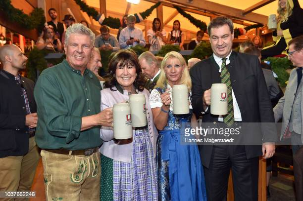 Munich Mayor Dieter Reiter with his wife Petra Reiter and Bavarian MinisterPresident Markus Soeder and his wife Karin Soeder during the opening of...