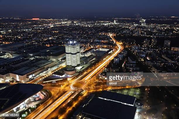 munich modern city night traffic aerial view, germany - münchen stockfoto's en -beelden