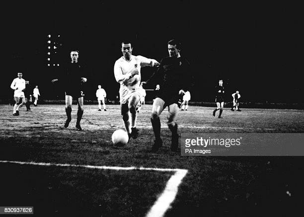 TSV Munich outsideleft Rebele and Chelsea leftback Eddie McCreadie race for the ball in the forth round of the InterCities Fairs Cup tie at Stamford...