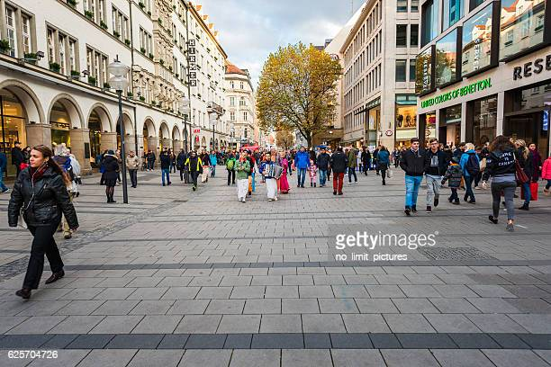 munich pedestrian zone with some hare krishna dancers - pedestrian zone stock pictures, royalty-free photos & images