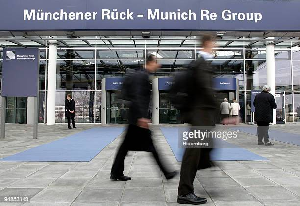 Munich Re shareholders pass the entrance to the company's annual shareholders' meeting in Munich Germany on Thursday April 17 2008 Munich Re the...