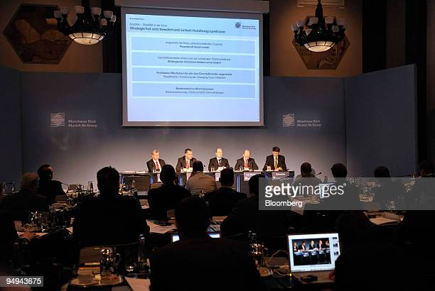 Munich Re's executives left to right Torsten Jeworrek management board member Torsten Oletzky management board member Christian Lawrence head of...