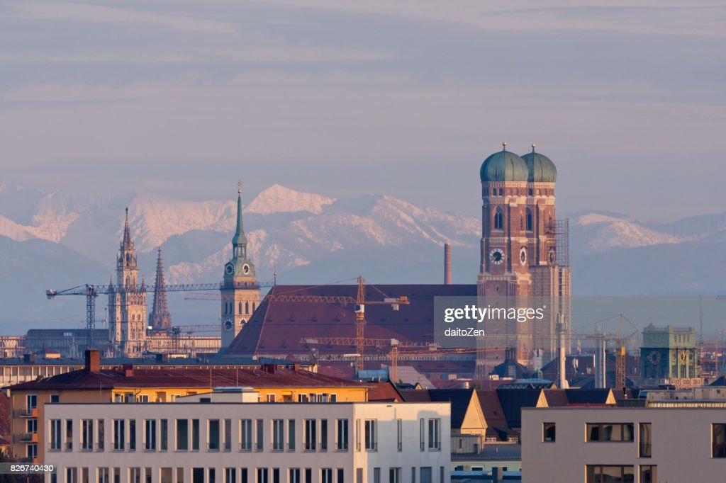 Munich skyline with Frauenkirche Cathedral and Alps mountain range in the background, Munich, Bavaria, Germany : Stock Photo