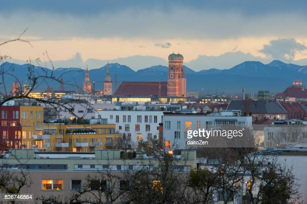Munich skyline with Frauenkirche Cathedral and Alps mountain range in the background, Munich, Bavaria, Germany.