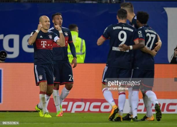Munich's Arjen Robben Corentin Tolisso Robert Lewandowski Niklas Süle and David Alaba celebrate the 01 during the German Bundesliga soccer match...