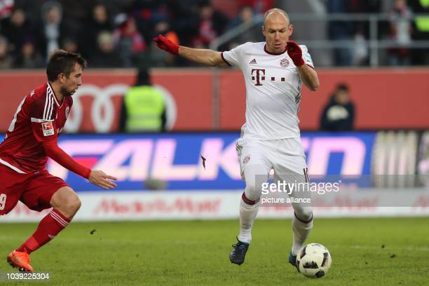 Munich's Arjen Robben shoots the 02 goal next to Ingolstadt's Markus Suttner during the Bundesliga soccer match between FCIngolstadt 04 and Bayern...