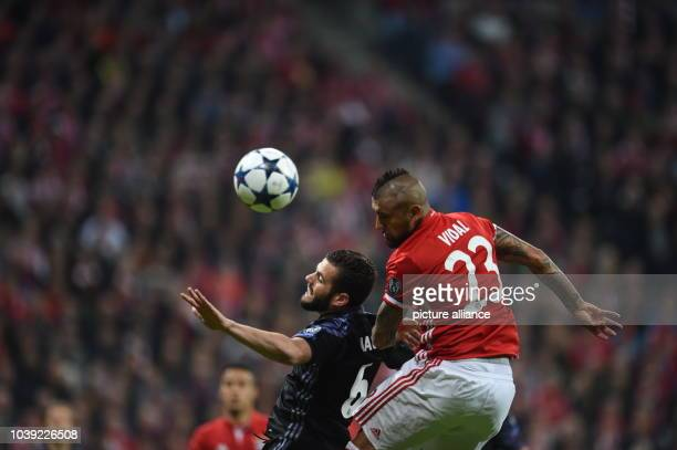 Munich's Arturo Vidal and Real Madrid's Nacho vie for the ball during the first leg of the Champions League quarter final match between Bayern Munich...