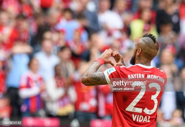 Munich's Arturo Vidal celebrates after giving his side a 20 lead during the German Bundesliga soccer match between Bayern Munich and SC Freiburg in...