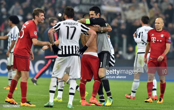 Munich's Arturo Vidal embraces Juve's Gianluigi Buffon after the UEFA Champions League round of 16 first leg soccer match between Juventus Turin and...