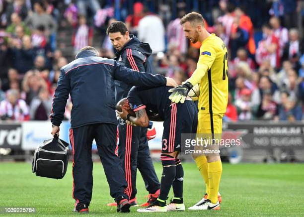 Munich's Arturo Vidal gestures next to Madrid's goalkeeper Jan Oblak during the Champions League semifinal match between Atletico Madrid and Bayern...