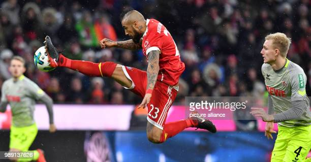 Munich's Arturo Vidal in action in front of Cologne's Frederik Soerensen during the German Bundesliga soccer match between Bayern Munich and 1 FC...
