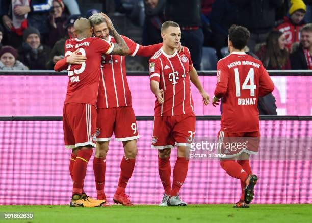 Munich's Arturo Vidal Robert Lewandowski Joshua Kimmich and Juan Bernat cheer over the 20 score during the Bundesliga soccer match between Bayern...