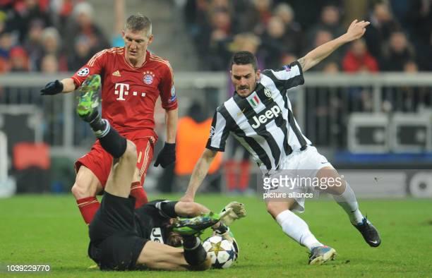 Munich's Bastian Schweinsteiger and Turin's Gianluigi Buffon and Leonardo Bonucci vie for the ball during the UEFA Champions League quarter final...
