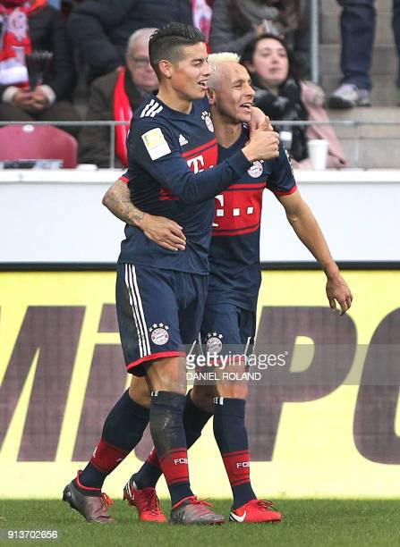 Munich's Bayern Munich's Colombian midfielder James Rodriguez celebrates with teammates after scoring a goal during the German first division...