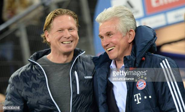 Munich's coach Jupp Heynckees and Hamburg's coach Markus Gisdol seen prior to the German Bundesliga soccer match between Hamburger SV and Bayern...