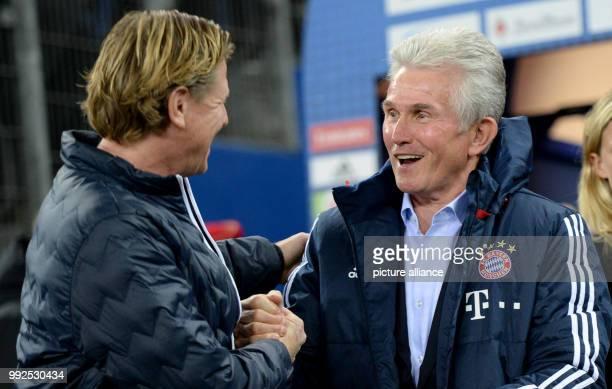 Munich's coach Jupp Heynckees and Hamburg's coach Markus Gisdol shake hands prior to the German Bundesliga soccer match between Hamburger SV and...