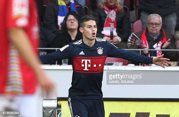 Munich's Colombian midfielder James Rodriguez celebrates after scoring during the German first division Bundesliga football match Mainz 05 versus...