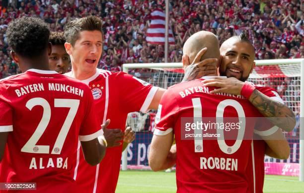 Munich's David Alaba Kingsley Coman Robert Lewandowski Arjen Robben and Arturo Vidal celebrate Robben's goal gives the team a 10 lead during the...