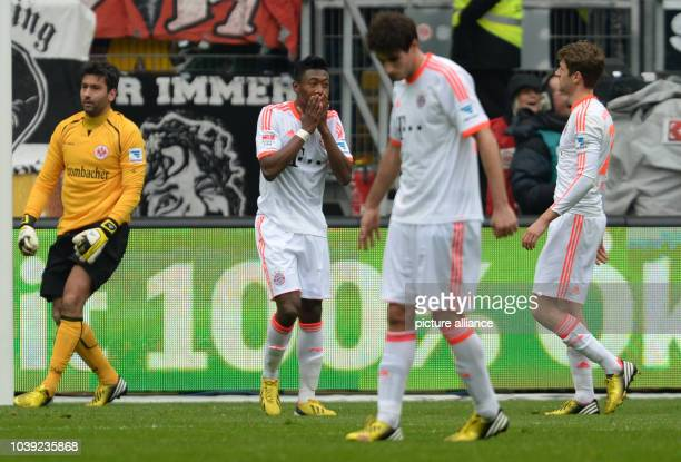 Munich's David Alaba reacts to his missed penalty against Frankfurt's goalkeeper Oka Nikolov  next to his teammates Javi Martinez and Thomas Mueller...