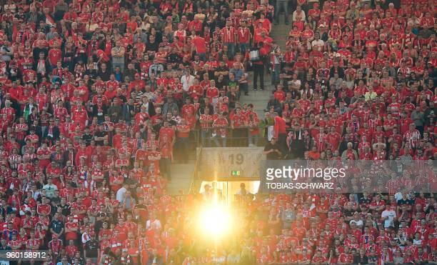 Munich's fans follow proceedings during the German Cup DFB Pokal final football match FC Bayern Munich vs Eintracht Frankfurt at the Olympic Stadium...