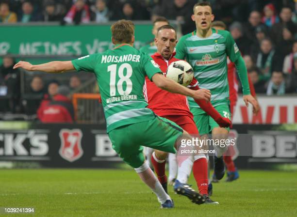 Munich's Franck Ribery and Bremen'S Niklas Moisander fight for the ball during the German Bundesliga soccer match between Werder Bremen and Bayern...