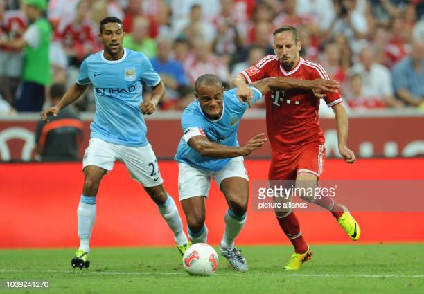 Munich's Franck Ribery and Vincent Kompany and Gael Clichy of Manchester vie for the ball during the Audi Cup soccer final match FC Bayern Munich vs...