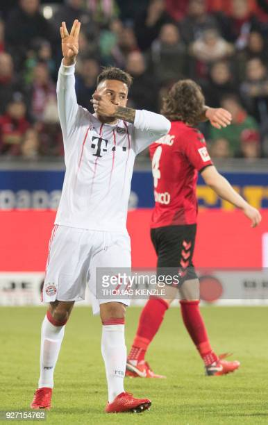 Munich's French midfielder Corentin Tolisso celebrates after he scored during the German first division Bundesliga football match SC Freiburg versus...