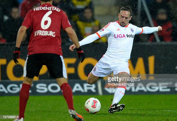Munich's French midfielder Franck Ribery shoots past Freiburg's Norwegian defender Vegar Hedenstad during the German first division Bundesliga...