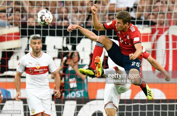 Munich's German midfielder Thomas Mueller goes for the ball during the German first division Bundesliga football match VfB Stuttgart vs FC Bayern...