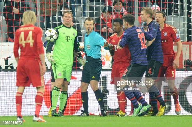 Munich's goalkeeper Manuel Neuer and Arsenal's Oliver Giroud react during the Champions League round of 16 second leg soccer match between FC Bayern...