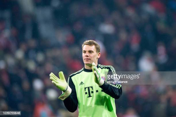 Munich's goalkeeper Manuel Neuer reacts after the 02 during the Champions League round of 16 second leg soccer match between FC Bayern Munich and...