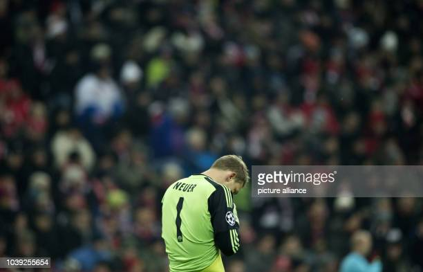 Munich's goalkeeper Manuel Neuer reacts after the Champions League round of 16 second leg soccer match between FC Bayern Munich and Arsenal FC at...