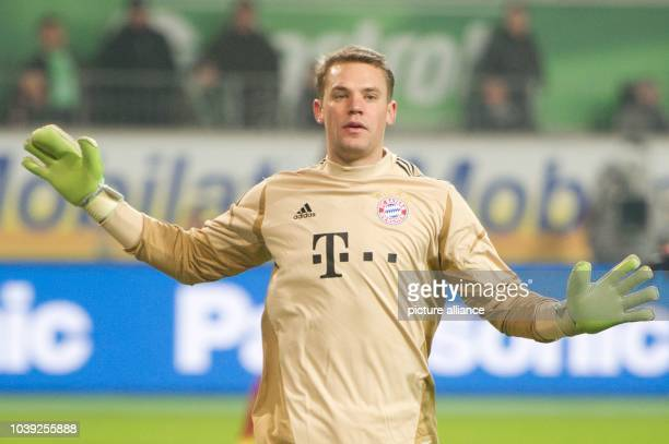 Munich's goalkeeper Manuel Neuer wears gloves with one finger for the index and ring fingers during the German Bundesliga soccer match between VfL...