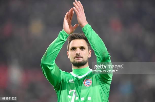 Munich's goalkeeper Sven Ulreich greets the fans after the German first division Bundesliga football match between VfB Stuttgart and Bayern Munich on...