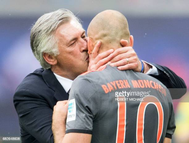 Munich´s head coach Carlo Ancelotti kisses scorer Dutch midfielder Arjen Robben after his goal during the German first division Bundesliga football...