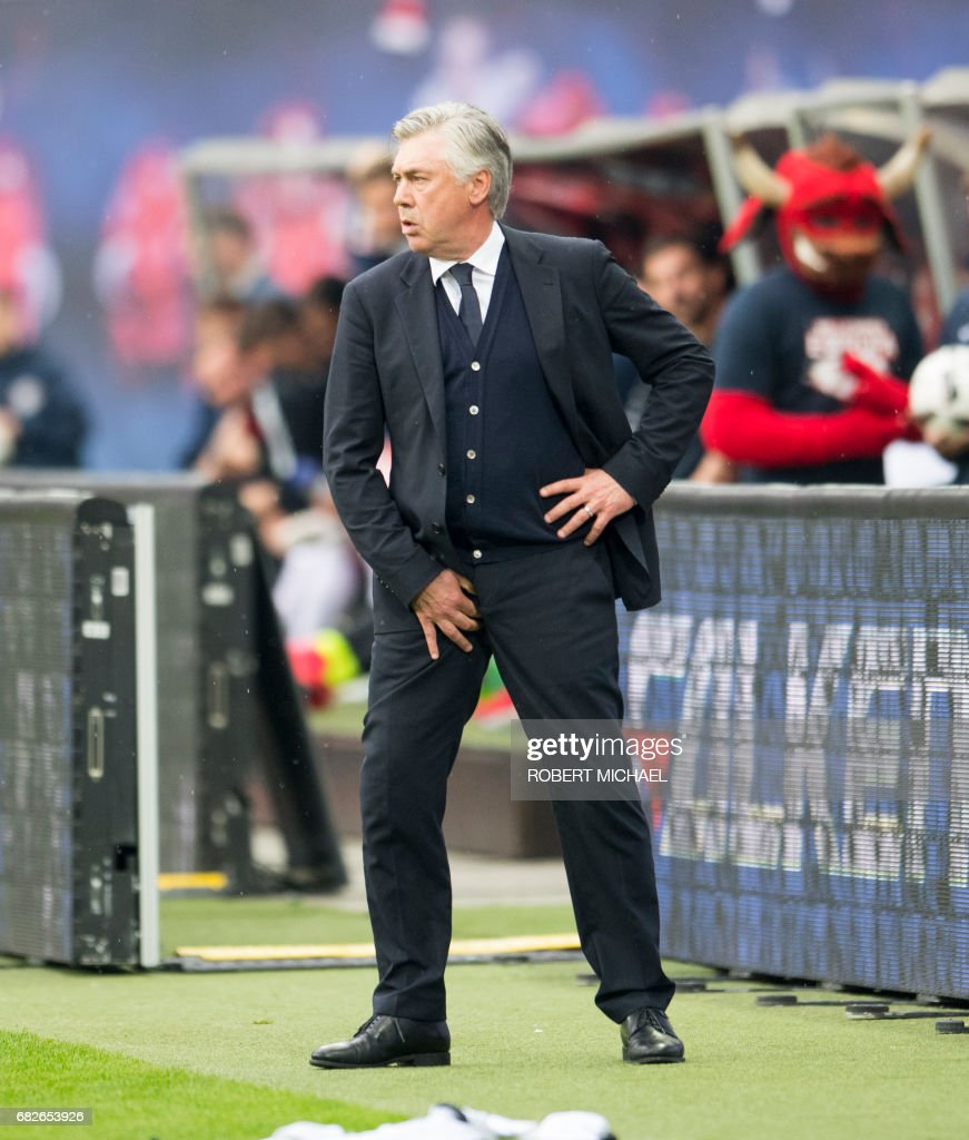 Munich´s head coach Carlo Ancelotti reacts as he follows the German first division Bundesliga football match between RB Leipzig and FC Bayern Munich in Leipzig, eastern Germany on May 13, 2017. /