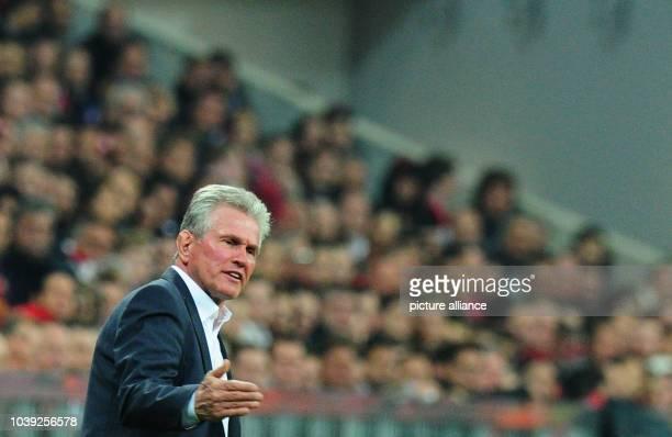 Munich's head coach Jupp Heynckes gestures during the UEFA Champions League semi final first leg soccer match between FC Bayern Munich and FC...