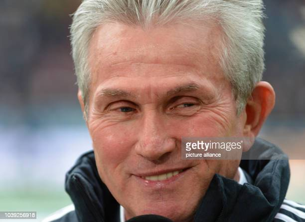 Munich's head coach Jupp Heynckes smiles during a television interview before the start of the Bundesliga soccer between Eintracht Frankfurt and...
