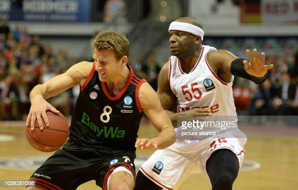 Munich's Heiko Schaffartzik and Bamberg's Dawan Robinson vie for the ball during the Eurocup basketball match between FC Bayern Munich and Brose...