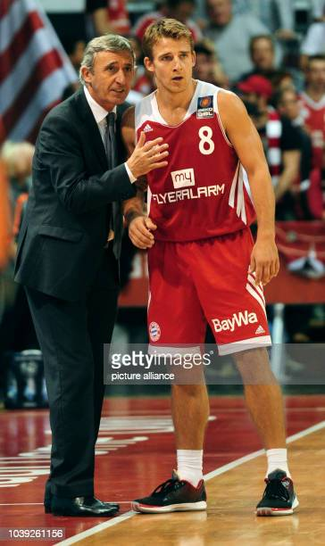 Munich's Heiko Schaffartzik gets directions from Svetislav Pesic during the German Bundesliga basketball match between FC Bayern Munich and Skyliners...