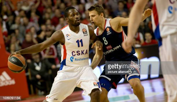 Munich's Heiko Schaffartzik  goes up against Moscow's Jeremy Pargo during the Euroleague group F intermediate stage basketball match between...