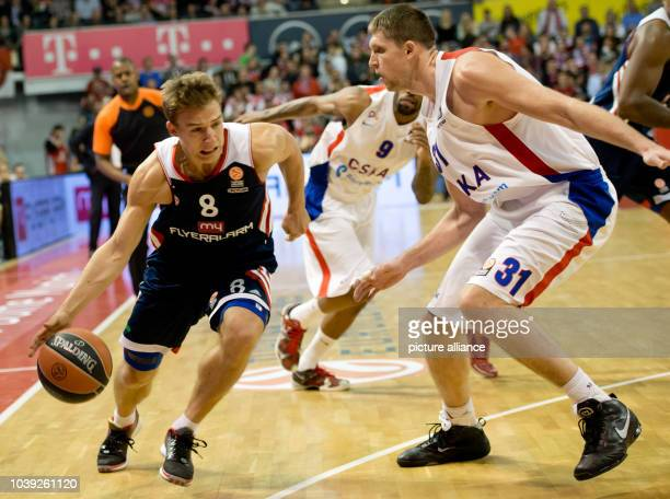 Munich's Heiko Schaffartzik  goes up against Moscow's Victor Khryapa during the Euroleague group F intermediate stage basketball match between...