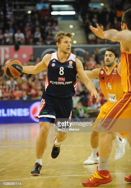 Munich's Heiko Schaffartzik vies for the ball with Istanbul's Engin Atsur during the Euroleague basketball group C match between FC Bayern Munich and...