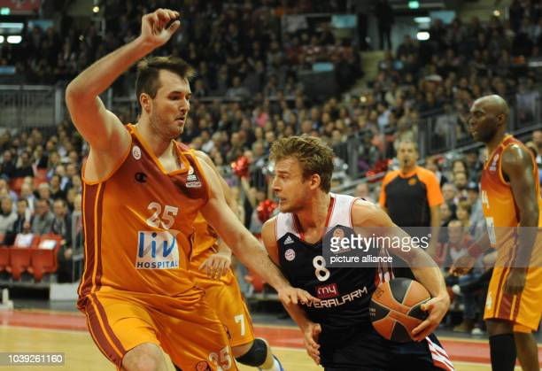 Munich's Heiko Schaffartzik vies for the ball with Istanbul's Milan Macvan during the Euroleague basketball group C match between FC Bayern Munich...