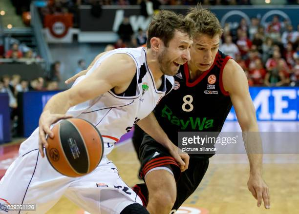 Munich's Heiko Schaffartzik vies for the ball with Zgorzelec's Lukasz Wisniewski during the Euroleague basketball match between Bayern Munich and...